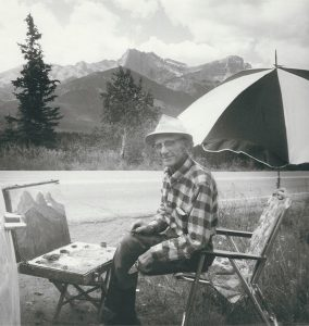Photo of W.J. Hopkinson painting in Western Canada